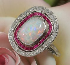 Early Art Deco opal, ruby, and diamond ring. This is just too awesome. can I alternate the rubies with seed pearls? Art Deco Jewelry, Opal Jewelry, Jewelry Rings, Jewelry Accessories, Jewelry Design, Ruby And Diamond Necklace, Ruby Diamond Rings, Opal Rings, Antique Jewelry