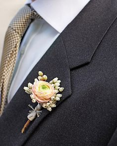 """""""Olly wore a boutonniere of mini ranunculus and pieris.""""  source: Martha Stewart Weddings    Next: Jewelry"""