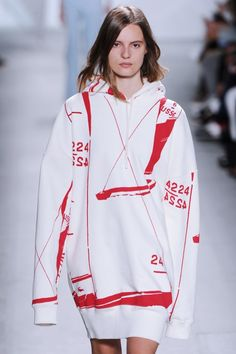 The yachting theme at the @Lacoste  #NYFW #MBFW #SS15 show went literal for this overgrown sweatshirt with sail identification numbers.