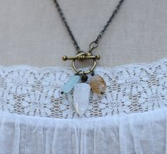 The Let It Go necklace is your invitation to set down what no longer serves you. It includes an aquamarine for courage, an ice quartz crystal for healing, clarifying, and purifying, and a citrine oval for dispelling negative energy. (Two more back in the shop.)