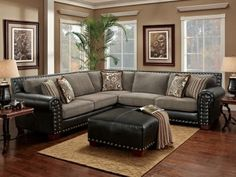 Black Studded Sectional w/ floral pillows.: