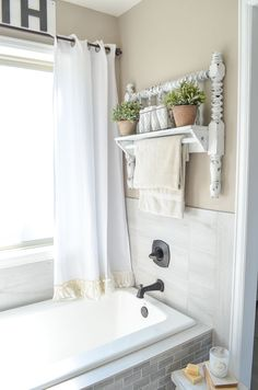 DIY Towel Bar from Vintage Bed Frame. Great farmhouse style decor idea for the bathroom.
