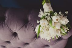 Bride: white tulips, white roses,  a few purple tulips, lavender, babys breath (& red berries?)