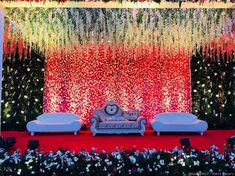 Do you want to make all your wedding stage pictures stand out but with a simple decor installation? Flower wall decor is the answer you seek. Read on to know how it will be perfect for your wedding ceremonies. Night Wedding Decor, Reception Stage Decor, Desi Wedding Decor, Wedding Stage Design, Wedding Hall Decorations, Luxury Wedding Decor, Wedding Reception Backdrop, Wedding Mandap, Backdrop Decorations