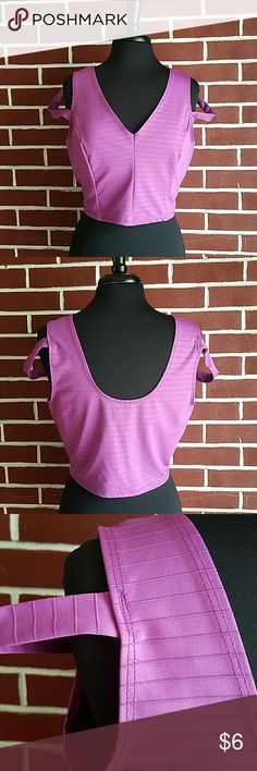 """Purple crop top 90% polyester  10% Spandex 16"""" length  37"""" across bust  True color is more of a purple Tops Crop Tops"""