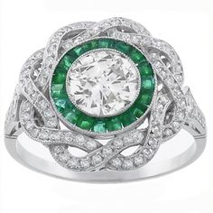 Art Deco 0.95ct Old Mine Diamond Emerald Platinum Engagement Ring, The ring is set with a sparkling old mine cut diamond that weighs approx 0.95ct. The center stone is accentuated by vivid square cut emeralds that weigh 0.48ct. . Around the emerald stones are glittering round cut diamonds that weighs approximately 0.78ct.
