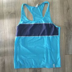 Under Armour racerback running tank top Medium FITTED racerback tank top. Has some reflective stripes on it for safe running! is a mesh sort of fabric as shown in the last picture  - it's not totally see through. 96% polyester 4% elastane. Under Armour Tops Tank Tops