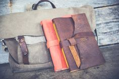 Large brown leather journal with mustard yellow pages and stitching, handmade in Nashville, Tennessee by Katie Gonzalez.