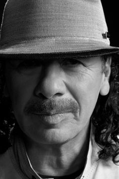 ۞ Carlos Santana, born 1947, in Autlán de Navarro, Jalisco, Mexico, is a Mexican-American musician who first became famous with his band, Santana, which pioneered a fusion of rock and Latin American music. The band's sound featured his melodic, blues-based guitar lines set against Latin and African rhythms featuring percussion instruments such as timbales and congas not generally heard in rock music. Rolling Stone magazine listed Santana on their list of the 100 Greatest Guitarists of All…