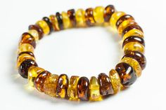 Luxury Baltic amber bracelet. Polished multicolor amber jewelry beads.