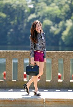 Top by Jack Willis, shorts and belt by J.Crew, shoes by Salvatore Ferragamo, bag by Mulberry, bracelets by Jeweliq. (August 30, 2012)