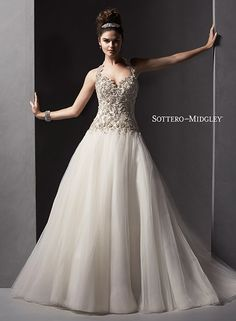 Tulle ballgown wedding dress with beaded Swarovski crystal bodice, halter neckline and stunning open back. Danica by Sottero and Midgley.