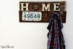 A pallet wood sign made with rusty funky junk makes a unique coat rack or wall hooks - KnickofTime.net