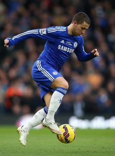 Eden Hazard Photos - Eden Hazard of Chelsea in action during the Barclays Premier League match between Chelsea and Burnley at Stamford Bridge on February 21, 2015 in London, England. - Chelsea v Burnley - Premier League