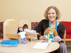 A Child Life/ Hospital Play Specialist helps with MRI preparation