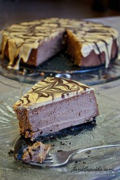Peanut Butter Chocolate Cheesecake by JavaCupcake.com
