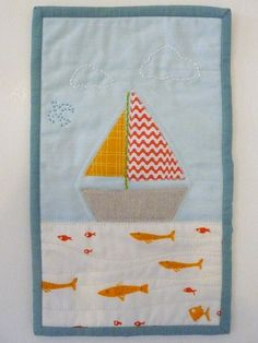 sailboat quilt, love the stitching.