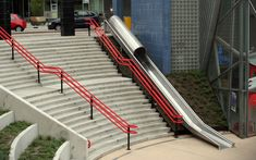 """""""This intervention by HIK Ontwerpers is officially called a 'transfer accelerator', but everyone else would say it's a slide. Installed next to a stairway at Utrecht's newly renovated Overvecht railway station, the slide offers travellers the opportunity to quickly reach the railway tracks when they're in a hurry. But above all, the slide is a great instrument to make the city more playful."""""""