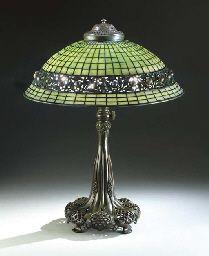 'JEWELED GEOMETRIC' LEADED GLASS AND BRONZE TABLE LAMP  TIFFANY STUDIOS, CIRCA 1910