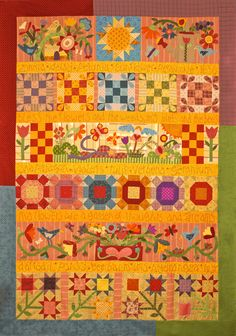 row quilt  Glory Garden presented by Silver Thimble Quilt Co. Pat Wys and BJ Laird designers.  www.silverthimblequilt.com