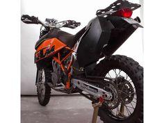 From here: http://blackdogcw.com/black-dog-shop/bike/ktm-950-super-enduro/950-super-enduro-rally-fuel-tank-detail.html
