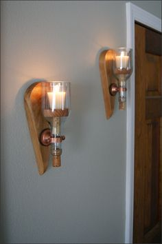 We design and handcraft each of our candlelight wooden wall sconce sets.    The price is per set (2) and a votive candle is included with each