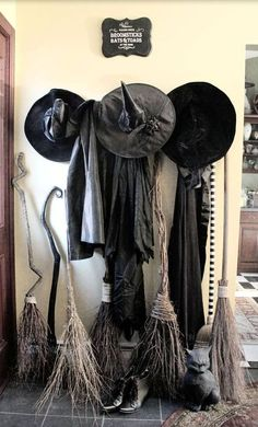 witches\' gowns, hats and brooms in the entryway