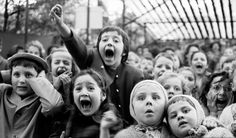 Kids Reacting To A Guignol Puppet Show snapped by photographer Alfred Eisenstaedt in 1963.