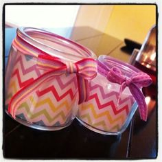 Recycled candle jars. These will hold my desk paperclips and pins. Rinse out completely, dry, cut strip of scrapbook paper, fit inside. Cut a piece of ribbon long enough to tie a bow around the outside edge and voila! :)