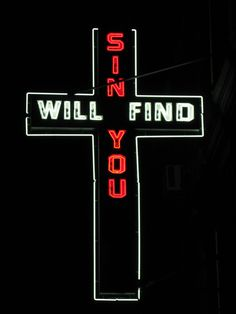 neon sign outside church in hell's kitchen, nyc