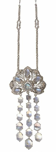 """Moonstone and diamond drop pendant necklace set with oval cabochon cut moonstones weighing in total approximately 22.77 ct.; single and full round cut diamonds weighing in total approximately 2.37 ct.; mounted in eighteen karat white gold; 26.1 grams; chain is 16"""" long and 22"""" long with pendant"""