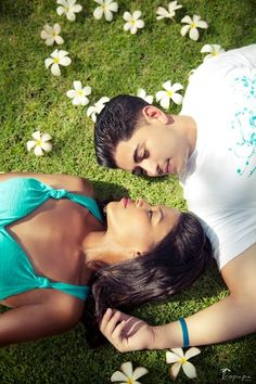 Beautiful couple lying on the green lawn among the tropical heart shaped flowers Honeymoon Photography, Green Lawn, German Language, Best Location, Beautiful Couple, Phuket, Love Story, Tropical, Romance