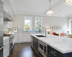White granite in this kitchen is called Pearl White. Similar look is Bianco Romano.