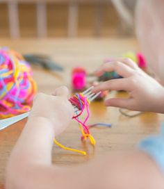 Tutorial on how to make pom pom ponytail holders with a fork! What a fun craft for girls!