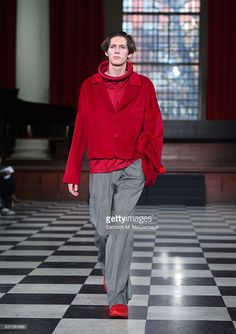 A model walks the runway at the ZHENHAO GUO - LCF MA17 show during London Fashion Week Men's January 2017 collections at St John's Smith Square on January 6, 2017 in London, England.