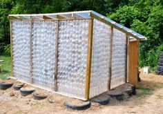 "A Very ""Green"" Greenhouse Made Of Soda Bottles. Not sure how the plastic reacts to the heat of the sun but I'd be interested to try this if it wouldn't poison anyone. Is it the plastic that gets toxic or just the contents of the container? Anyone know? What if you left the caps on the bottles?"