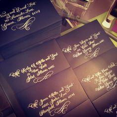 flourished calligraphy, dark envelope, white calligraphy ink, wedding envelopes  www.calligraphybyjennifer.net