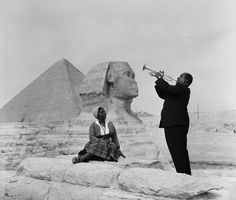 That's certainly an interesting place to give a concert. Taken in 1961, the iconic jazz musician Louis Armstrong performs for his wife at the Sphinx.
