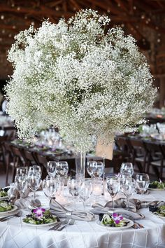 Babies breath centerpieces. Wedding celebration in West Yellowstone, Montana. Wedding Planning and Floral Design by Taylor'd Events. TaylordEventsSV.com