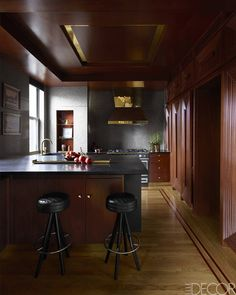 The kitchen stools and terrazzo countertop are custom made, as is the cabinetry; the sink fittings are by Waterworks, and new oak flooring inset with mahogany matches the existing flooring. Jim Luigs Gramercy Park Home - Venice-Inspired Manhattan Apartment - ELLE DECOR