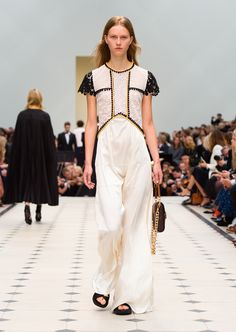 White silk crepe and lace long dress with regimental goldwork cording and The Belt Bag – Oblong in dark clove brown leather. Discover the collection at Burberry.com