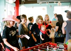 Glitter foosball table in action!  Church of Cupcakes, Grand Reopening Party