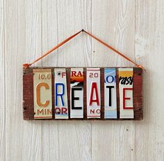 Turn salvaged wood into art by nailing old license plate letters to it.