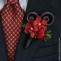 Google Image Result for http://www.rebeccassilverrose.com/weddings/boutonnieres/10boutonniere-mokara-orchid-fiddlehead.jpg
