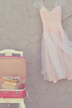 such a pretty dress and pink suitcase