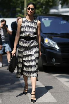 Caroline Issa chic in a belted dress and multi strap flats. Milan
