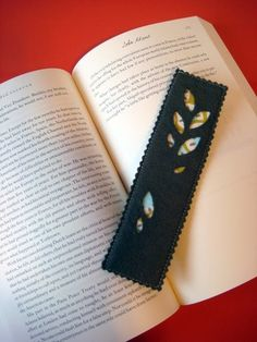 I made this bookmark for Josh as part of his Christmas present. I thought it turned out really fun. I got my inspiration from these book...