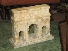 "A very fine Italian Grand Tour model the Arch of Constantine in carved alabaster. The model sits on a Carrara marble base which is marked ""ARCO DI COSTANTINO"", circa 1875-1900 - Dim: 6 in.Hx7.5 in.Wx2.75 in.D // 15 cmHx19 cmWx7 cmD"