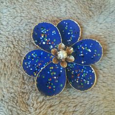 Vintage flower pin with adjustable petals Royal blue flower surg multi colored dots.. and a pearl in the middle. Jewelry Brooches