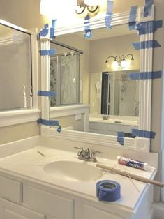 """With a few cuts and some glue transform your mirrors! When you hear """"builder grade"""" you probably have the same yellow/beige color I'm thinking of come to mind. You've seen those boring bathroom mirrors that are essentially just glass stuck to the wall. #d"""